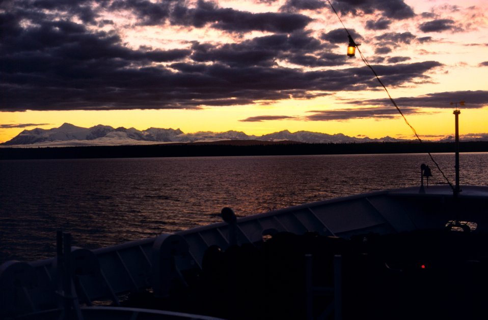 A sunset in Upper Cook Inlet taken from the bow of the FAIRWEATHER.