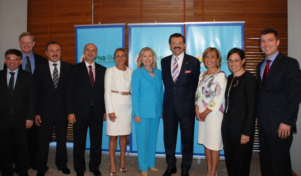 Secretary Clinton Poses for a Photo With Partners for a New Beginning Initiative Meeting Participants