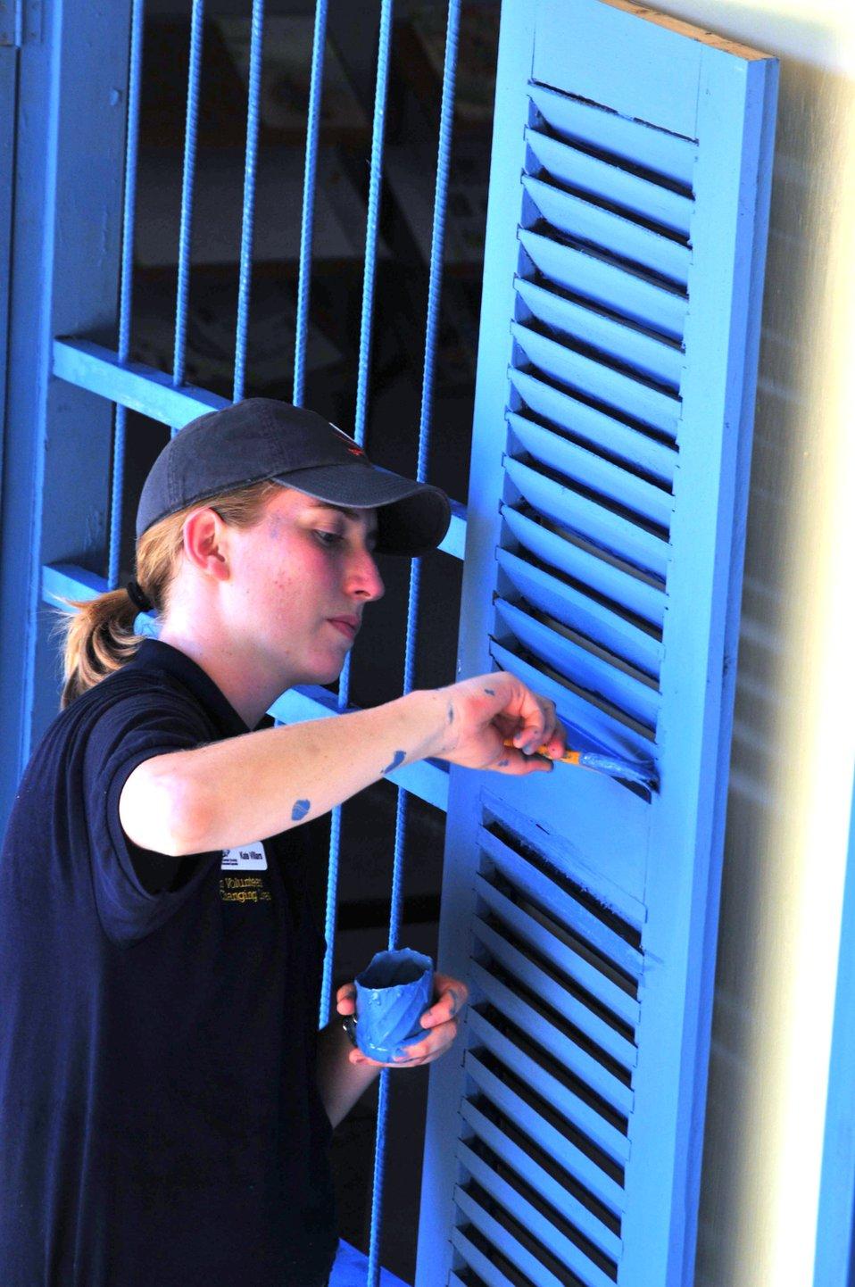 UVA Student Volunteer Kate Villars Paints Window Shutters
