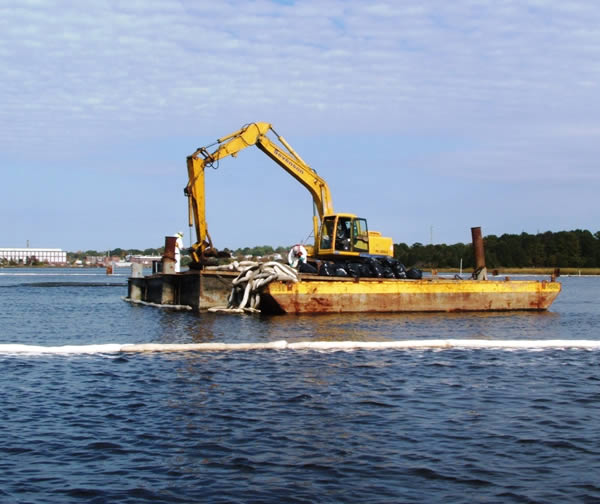 October 2009, Used oil boom is collected for proper disposal