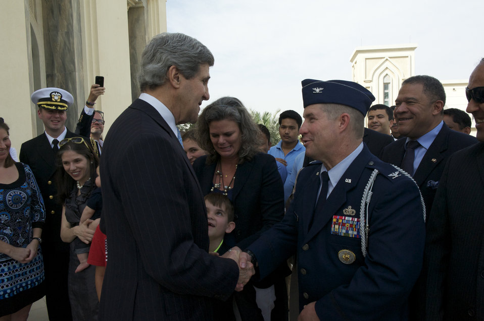Secretary Kerry Shakes Hands With Defense Attaché Officer Weingartner