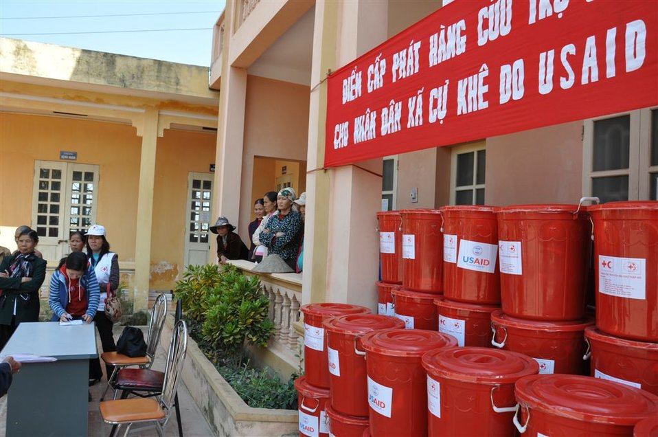 USAID and Red Cross officials distribute household kits following flooding near Hanoi.