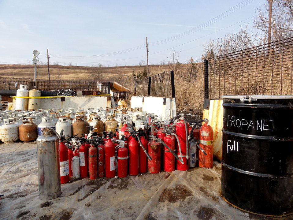 December 2, 2012 - Fire extinguishers, propane tanks organized for disposal.