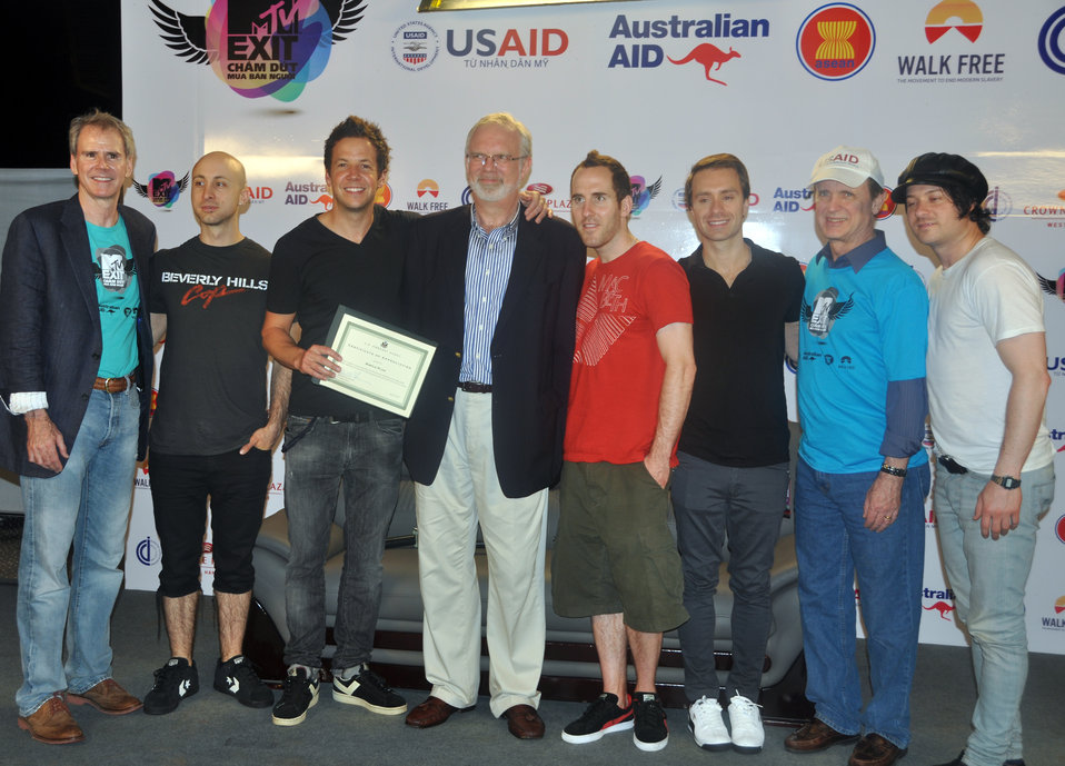 Simple Plan receive certificate from U.S. Ambassador David Shear at MTV EXIT concert against human trafficking and exploitation