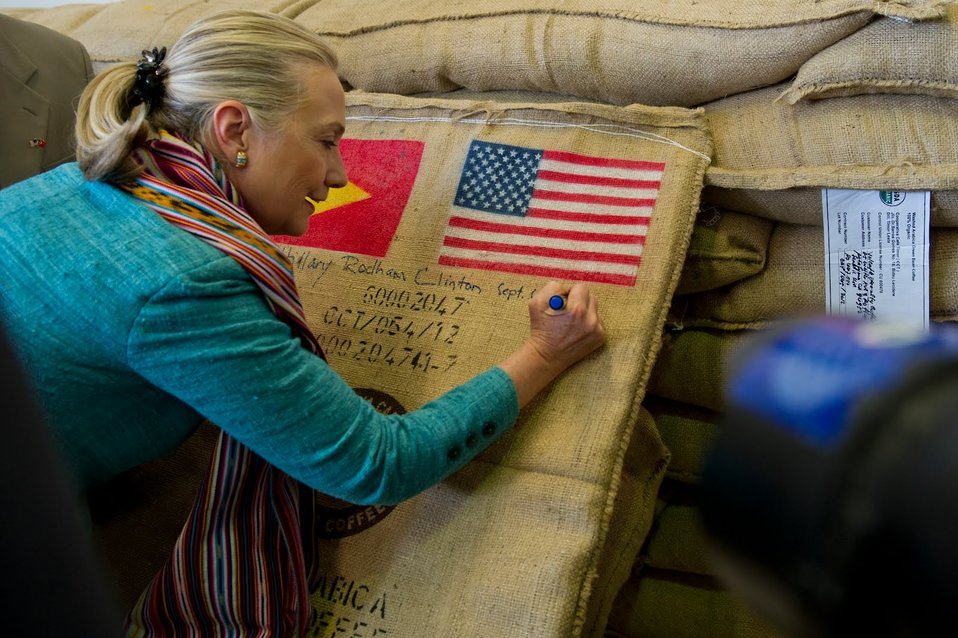Secretary Clinton Signs a Bag of Organic Coffee