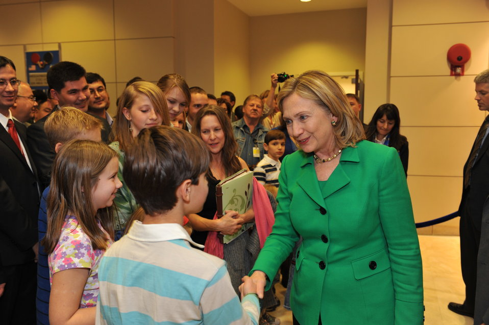 Secretary Clinton Shakes Hands With Children