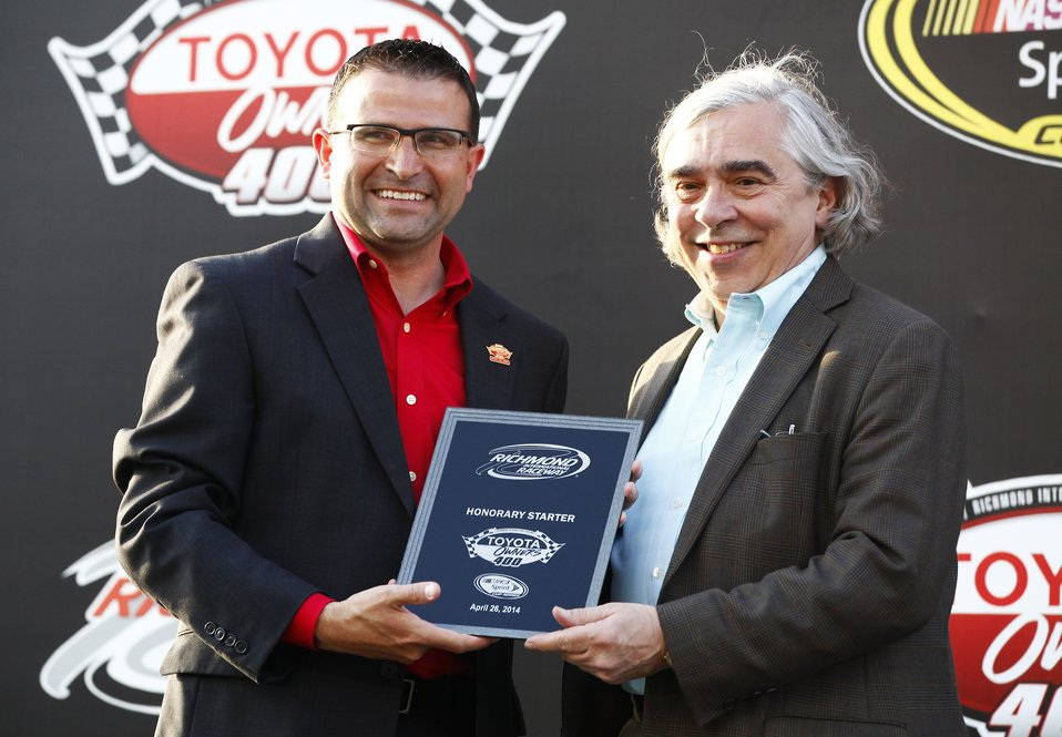 Secretary Ernest Moniz accepts an honorary plaque from the President of Richmond International Raceway Dennis Bickmeier during the pre-race