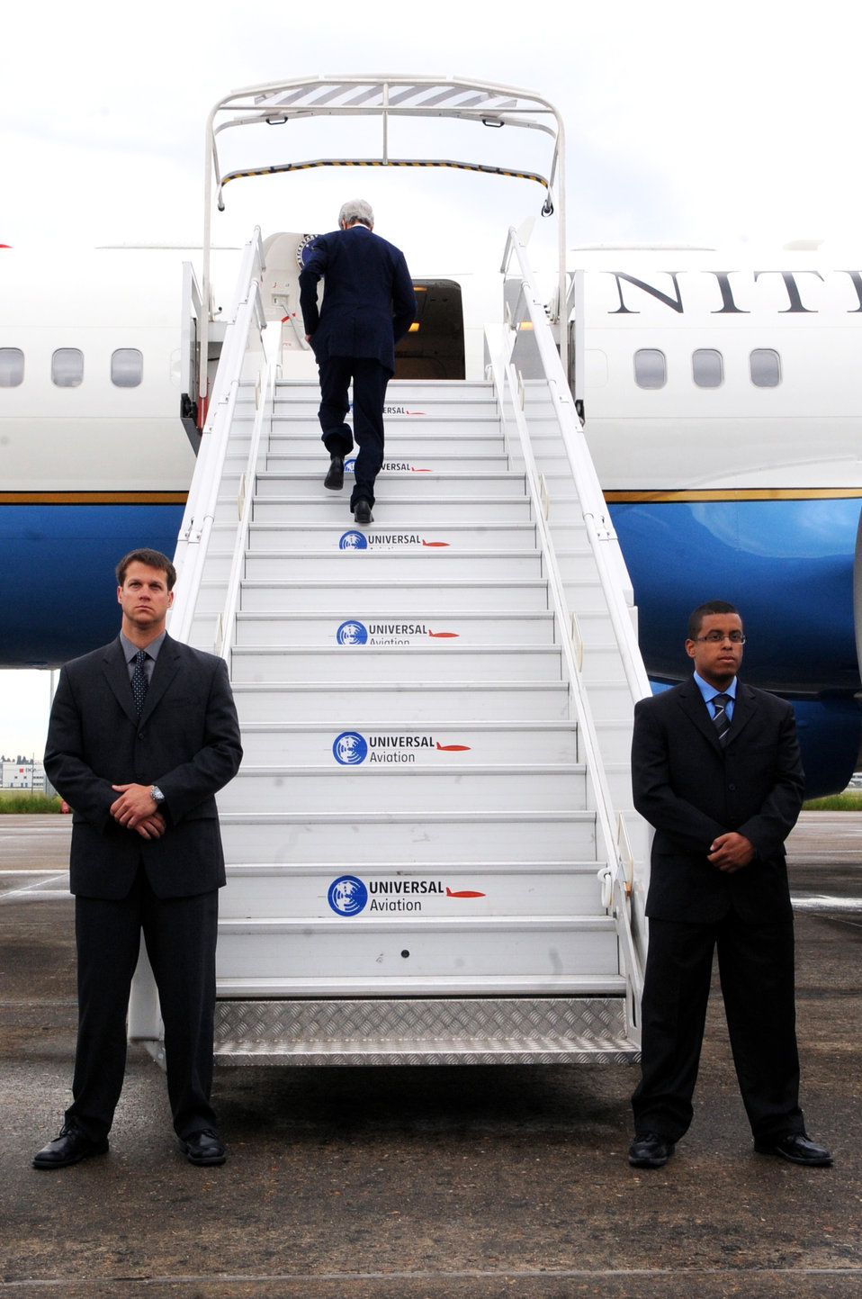 Secretary Kerry Climbs the Stairs of the Plane
