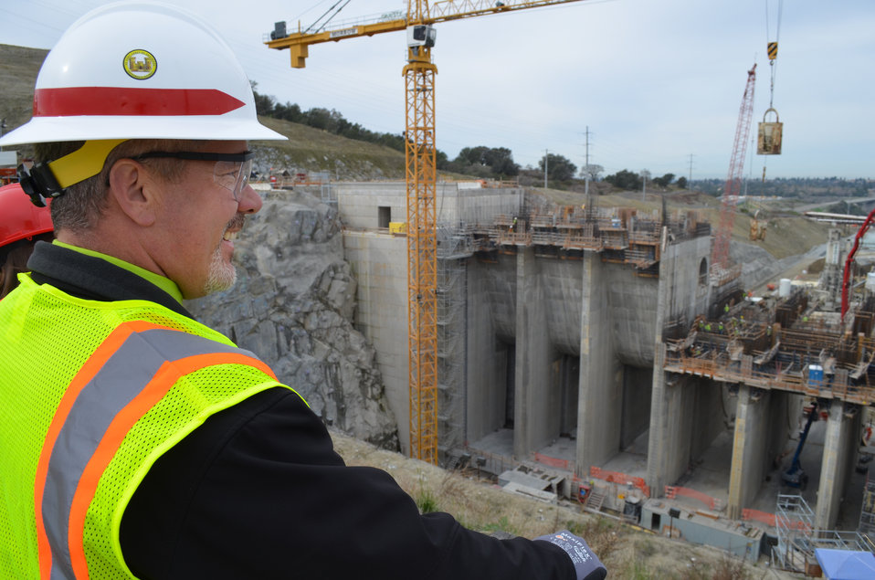 Greg Crannell vice principal of Folsom High School views Folsom Dam auxiliary spillway construction