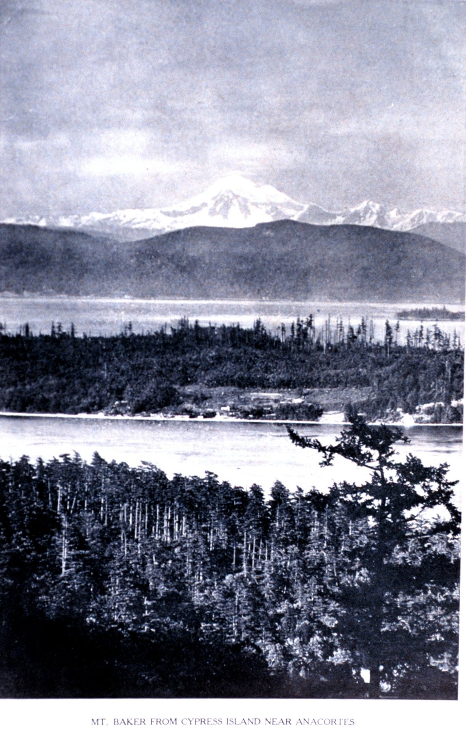 'Mt. Baker from Cypress Island, Near Anacortes'. In:  'Puget Sound and Western Washington  Cities-Towns Scenery', by Robert A. Reid, Robert A. Reid Publisher, Seattle, 1912.  P. 19.