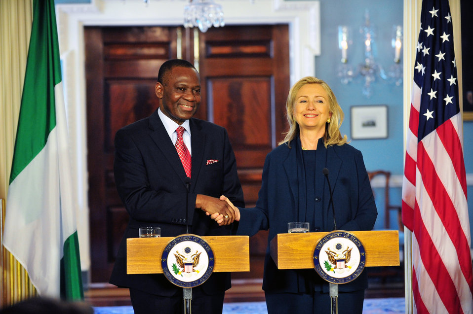 Secretary Clinton Shakes Hands With Nigerian Foreign Minister Ashiru
