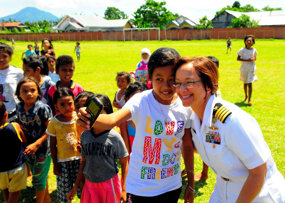 Pacific Partnership 2010 Commander Capt. Lisa M. Franchetti Poses for a Photo With an Indonesian Girl