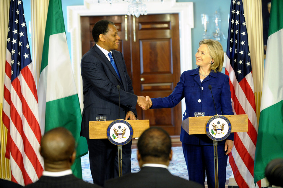 Secretary Clinton Shakes Hands With Nigerian Foreign Minister Ajumogobia