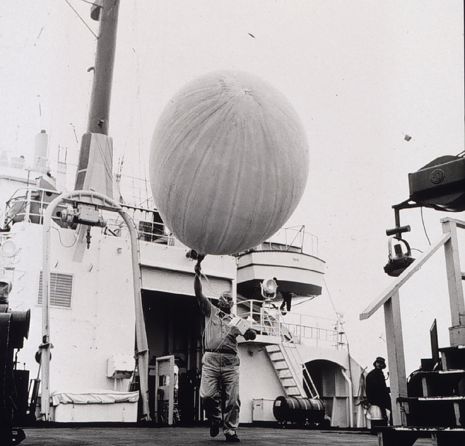 Meteorological radiosonde balloon being released. OCEANOGRAPHER around the world cruise
