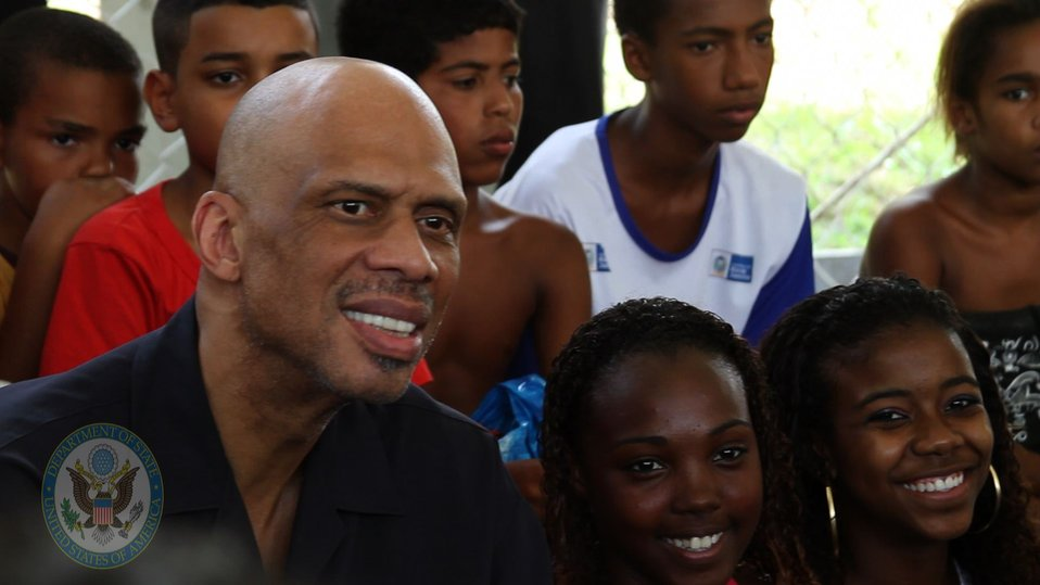 Global Cultural Ambassador Kareem Abdul-Jabbar Poses for a Photo With Young Brazilians