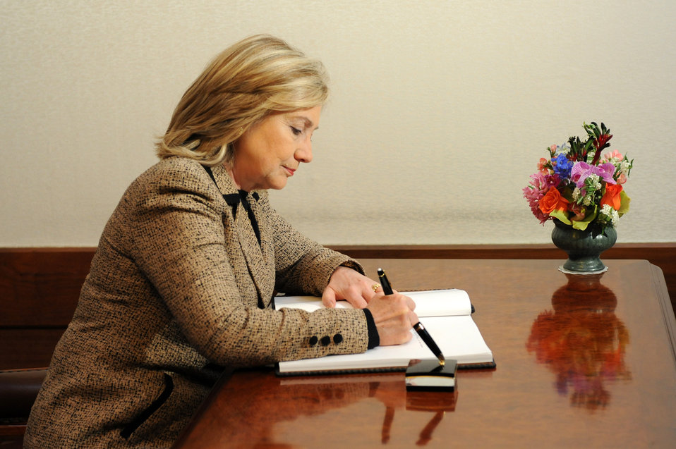 Secretary Clinton Signs Guest Book