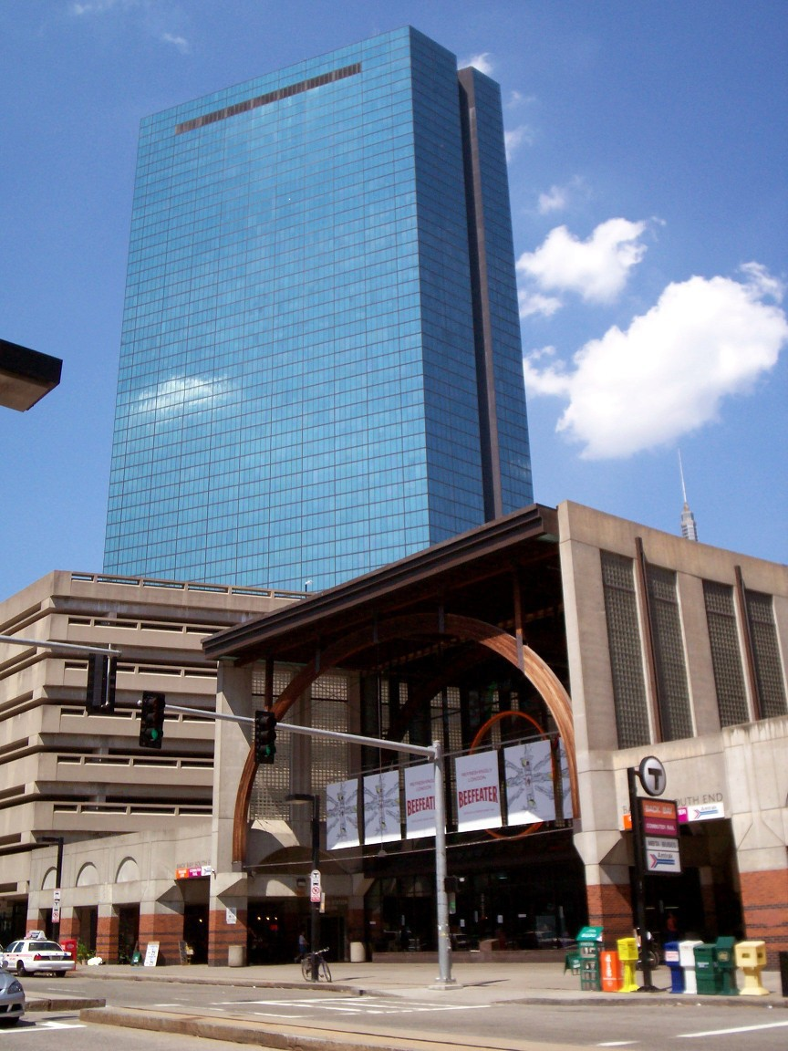 The main facade and entrance to Back Bay Station, served by Amtrak, MBTA Commuter Rail, and the MBTA Orange Line. The John Hancock Tower is in the background. This view is approximately northeast, from the west sidewalk of Dartmouth Street.