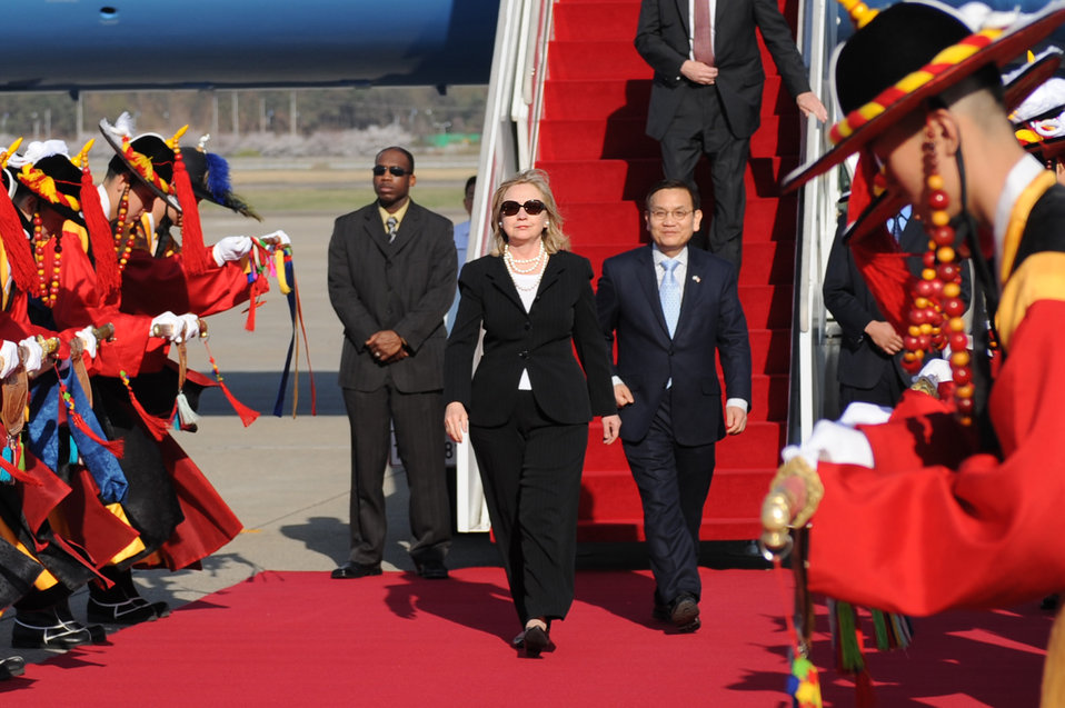 Secretary Clinton Is Escorted By Ministry of Foreign Affairs and Trade Deputy Director General Ahn Seung-doo