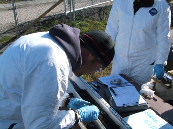 December 2009, Scientists process post dredging sediment cores