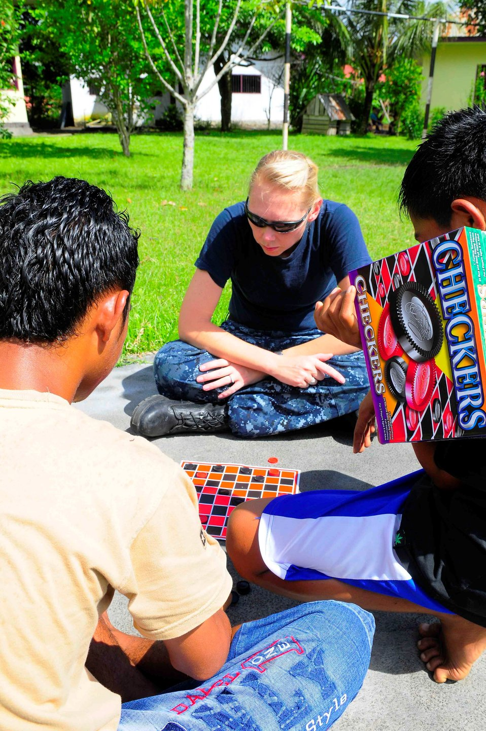 Religious Programs Specialist 1st Class Jennifer Snow Plays a Game of Checks With an Indonesian Boy