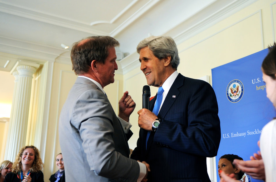Secretary Kerry Shakes Hands With Deputy Chief of Mission Stewart