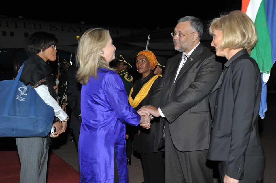 Secretary Clinton Is Greeted By Ambassador Rasool