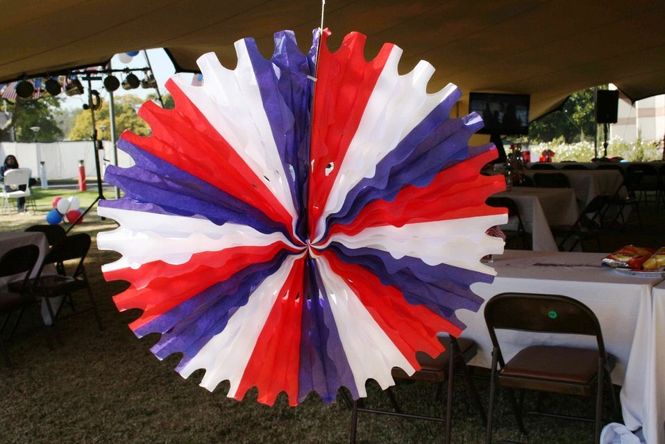 A Red, White, and Blue Decoration Hangs From the Tent
