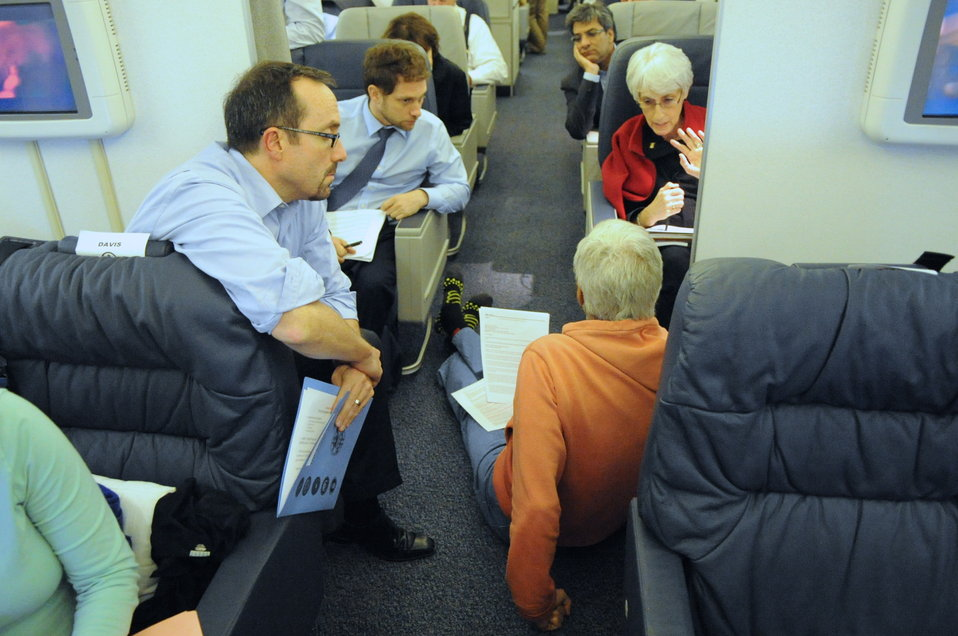 Secretary Kerry Holds In-Flight Staff Meeting