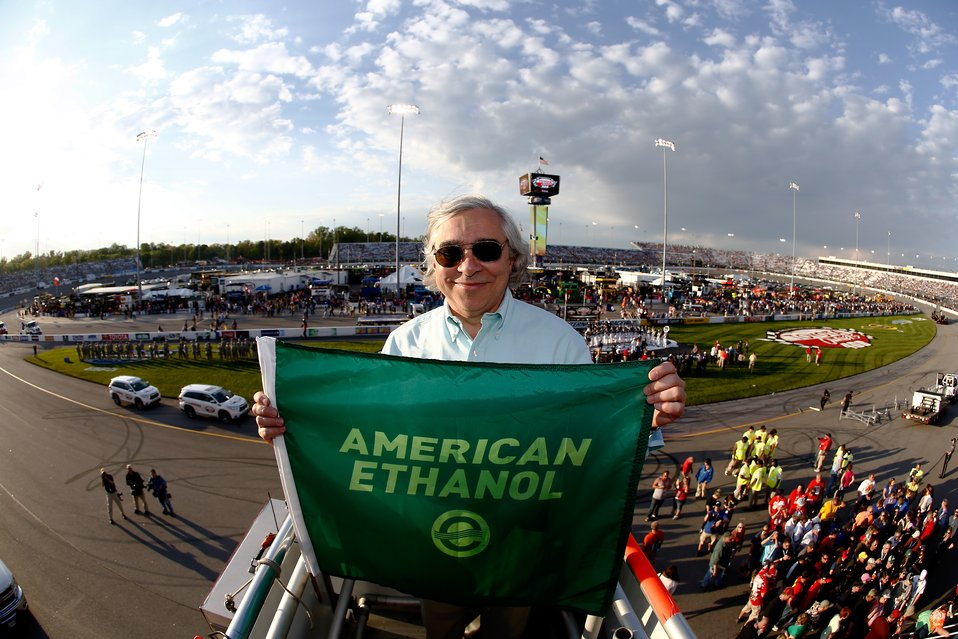 Secretary Ernest Moniz displays the green flag prior to the NASCAR race at the Richmond International Raceway. | Photo courtesy of Jeff Zele