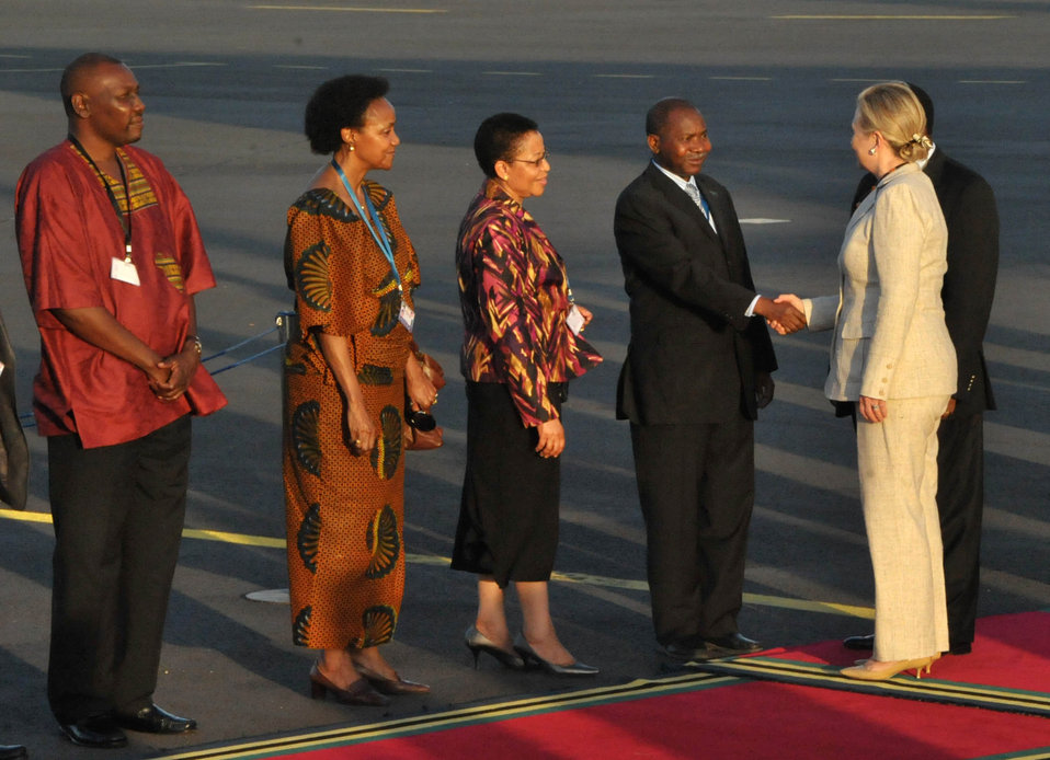 Secretary Clinton Is Greeted By Tanzanian Foreign Foreign Minister Membe