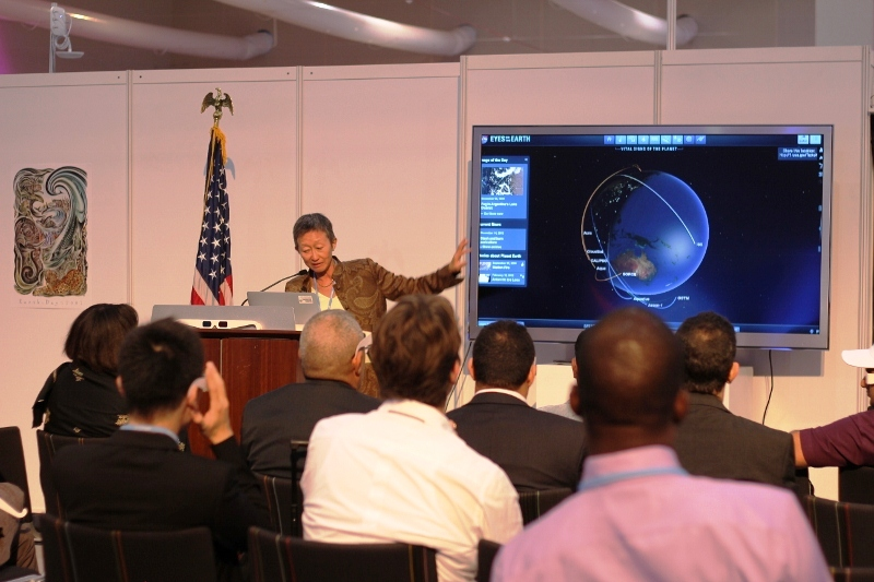 A U.S. Government Leader Presents at the U.S. Center