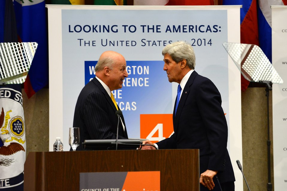 Secretary Kerry Shakes Hands With Ambassador Negroponte