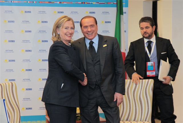 Secretary Clinton Shakes Hands With Italian Prime Minister Berlusconi
