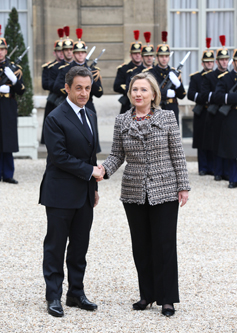 Secretary Clinton Is Welcomed By French President Sarkozy