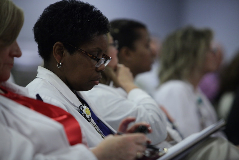 GW University Hospital Staff Taking Notes During FCC Chairman's Speech on MBANs