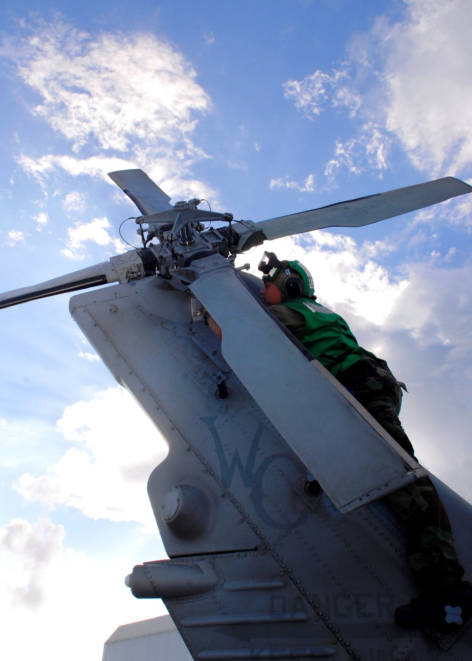 Aviation Machinist's Mate 3rd Class Sarah Rogers Checks the Oil Level in the Tail Gear Box of an MH-60S Knighthawk Helicopter