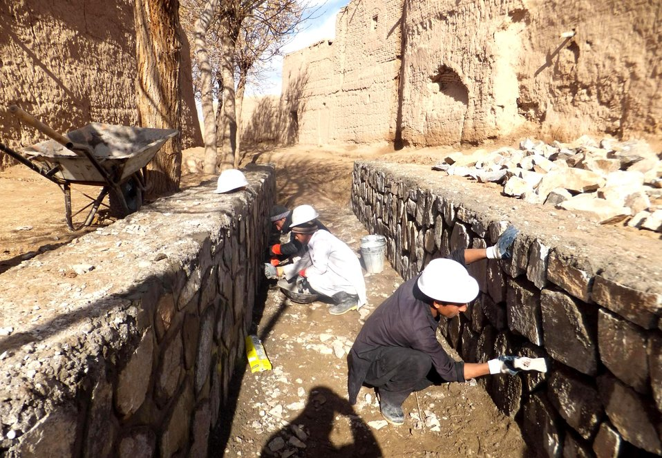 Laborers working to construct a flood protection wall in Salimi village in Pashtun Zarghun District