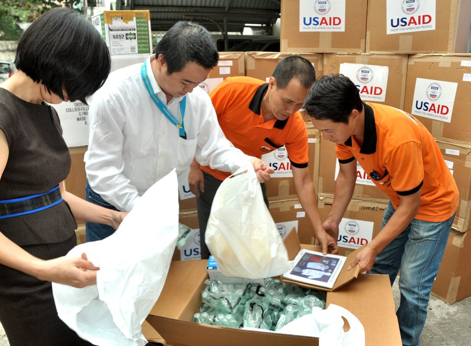 USAID hands over personal protective equipment to the Department of Animal Heath under Vietnam's Ministry of Agriculture and Rural Development.