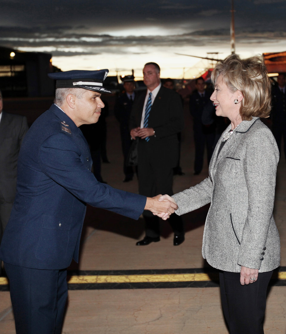 Secretary Clinton Greets Brazilian Air Base Colonel