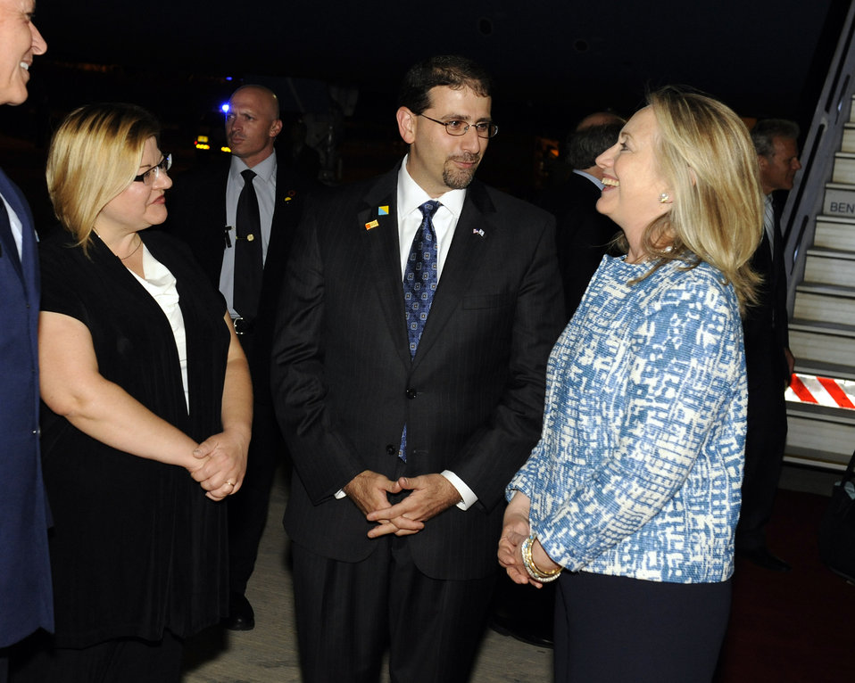 Secretary Clinton Is Greeted By Ambassador Shapiro and His Wife Julie Fisher