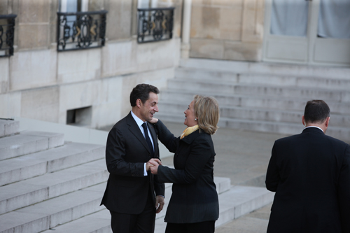 Secretary Clinton Is Greeted By French President Sarkozy