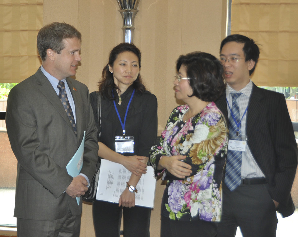 Acting Senior Deputy Assistant Administrator Jason Foley of USAID (left) and Ms. Phan Thi My Linh, Vice Minister of Vietnam's Ministry of Construction (right)