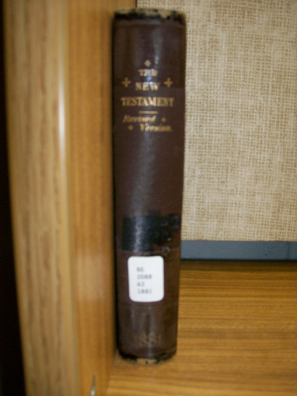 This is a photo I took of an antique copy of the 1881 Revised Version of the New Testament. I found this in the library at Calvary Bible College, hence the library marker on the spine. The photo is all my own work, and the RV Bible has never had any valid