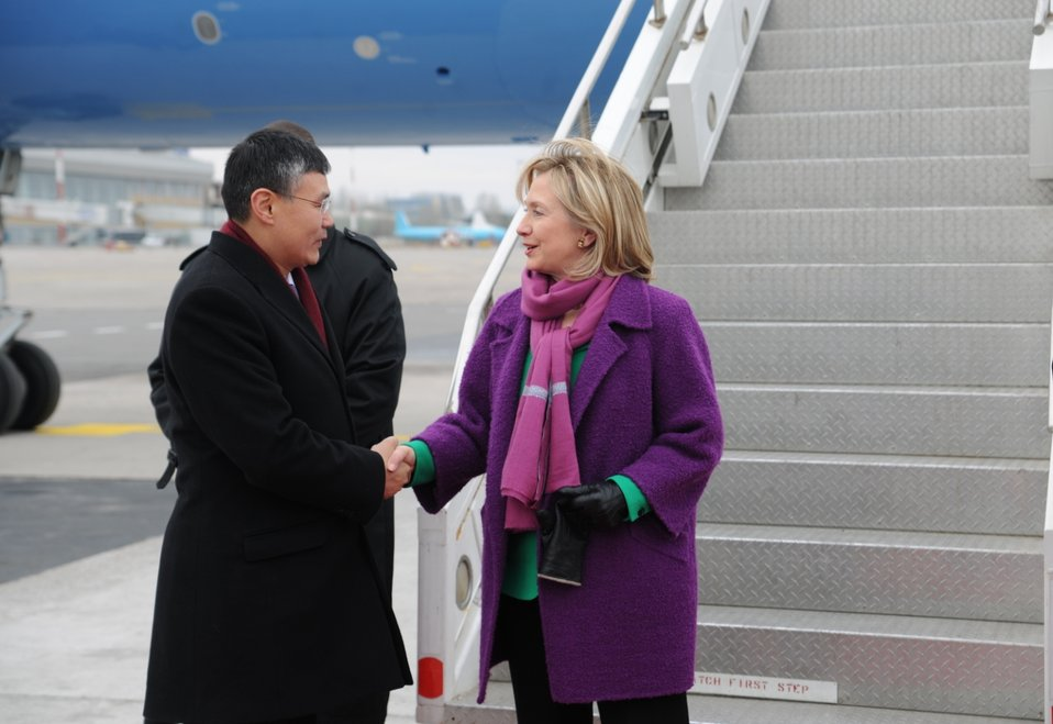 Secretary Clinton Is Greeted By Kyrgyz Chief of State Protocol of MFA Tentimishev