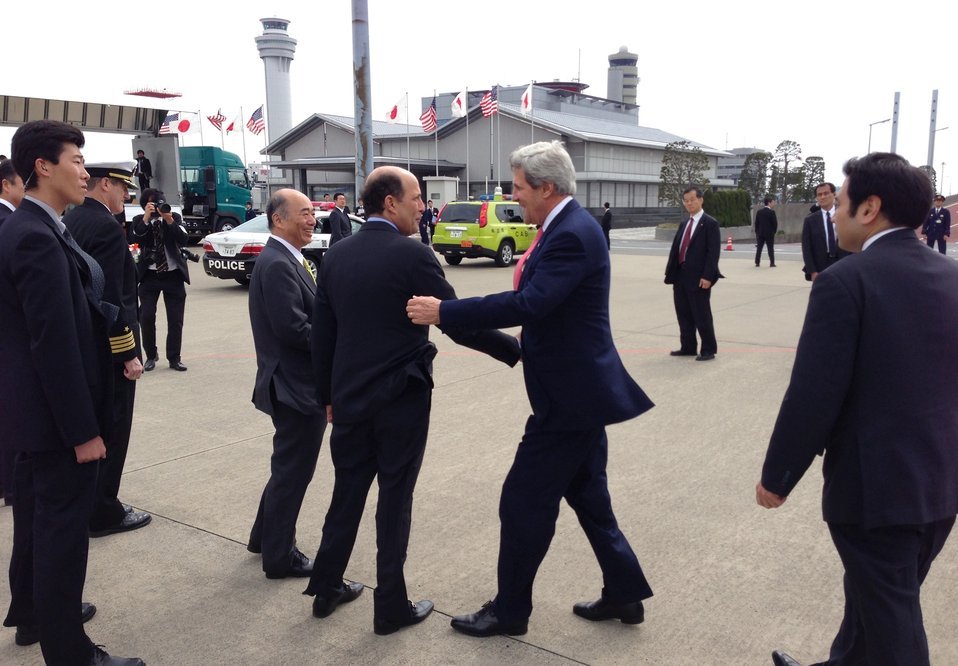 Secretary Kerry is Greeted by Ambassador Roos