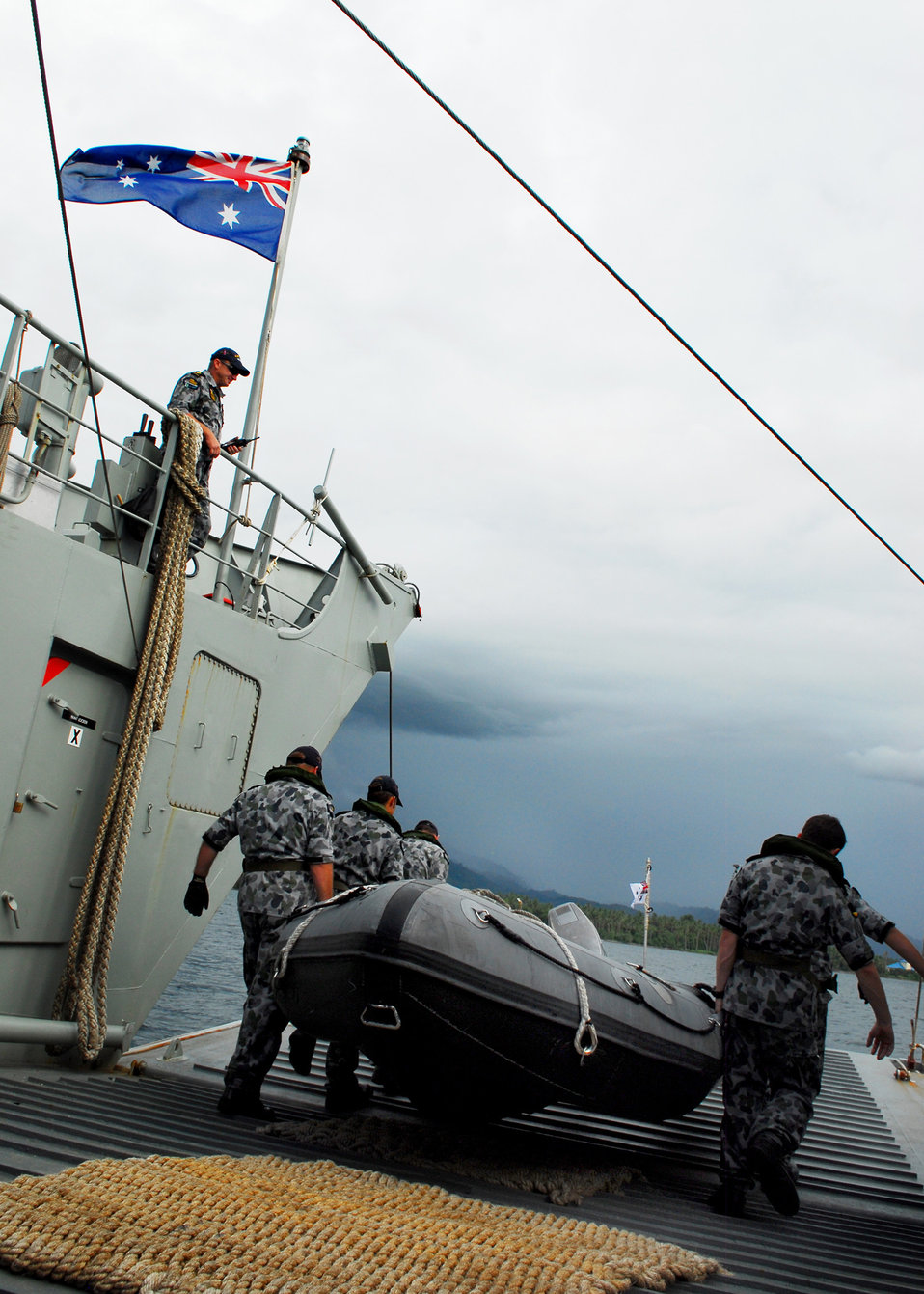 Australian Royal Navy Sailors Carry a Rigid Hull Inflatable Boat to the Water