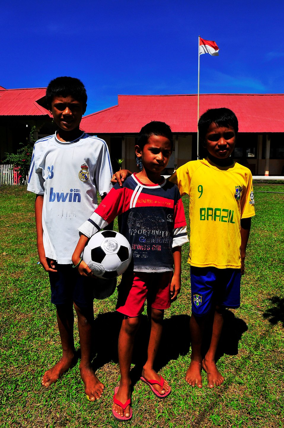 Local Indonesian Children Hold a New Soccer Ball