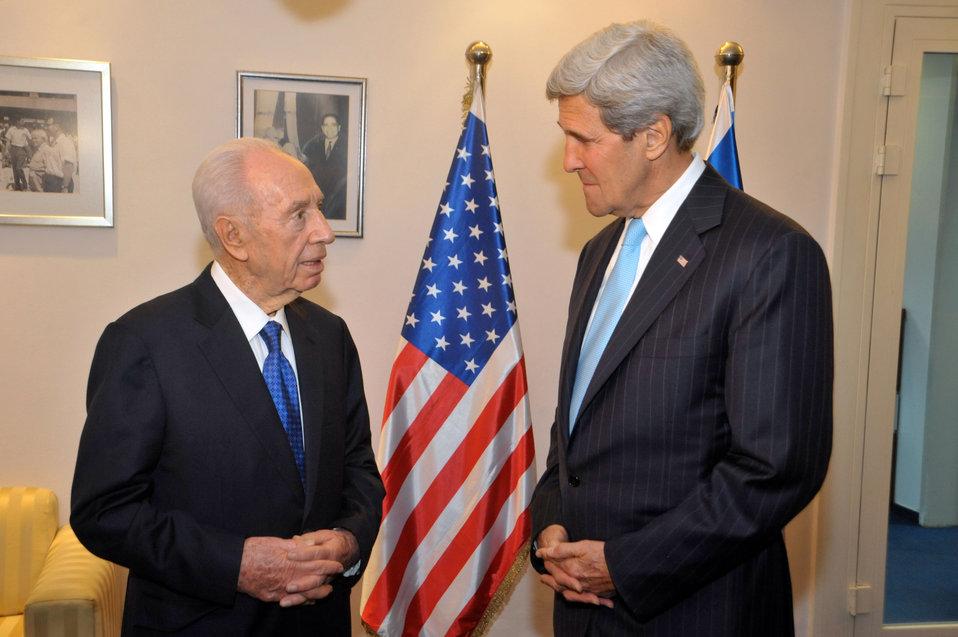Secretary Kerry Listens to Israeli President Peres
