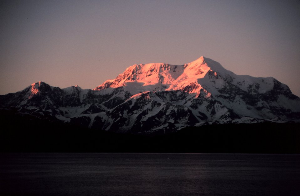 Photo #14 of Mount St. Elias sequence. Mount Saint Elias is one of the largest mountains visible from the sea on the North American continent.  It rises to a height of 18,008 feet in a distance of less than 20 miles from sea level at Icy Bay.