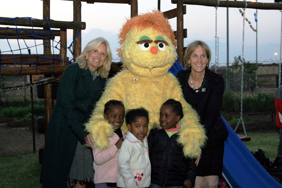 Dr. Jill Biden, Liz Berry Gips, South African Children, and Kami Pose for a Photo